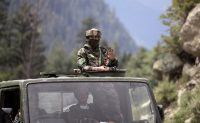 Indian army soldiers at Gagangeer in Indian-controlled Kashmir on Tuesday. (Mukhtar Khan/AP)