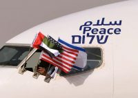 The Emirati, U.S. and Israeli flags are pictured attached to an airplane of Israel's El Al upon its arrival at the Abu Dhabi airport in the first commercial flight from Israel to the United Arab Emirates on Aug. 31. (Karim Sahib/AFP/Getty Images)