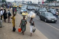 Women sell products along a road in Lagos, Nigeria, on Sept. 14. (Akintude Akinleye/EPA-EFE)