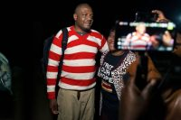Zimbabwean journalist Hopewell Chin'ono, left, with a supporter after his release on bail from Chikurubi Maximum Security Prison in Harare on Sept. 2. (Jekesai Njikizana/AFP/Getty Images)