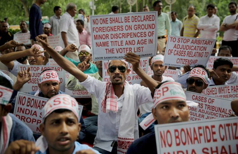 Activists protest against the final draft of the National Register of Citizens in the northeastern state of Assam, in New Delhi, India, on Aug. 4, 2018. (Altaf Qadri/AP)