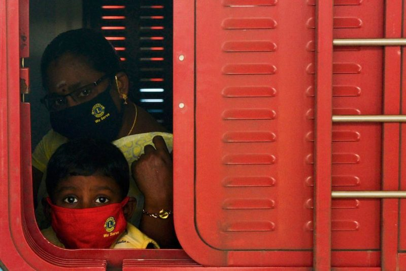 A child peeps from a window of a special train at Egmore railway station in Chennai, India, on Tuesday. (Arun Sankar/AFP/Getty Images)