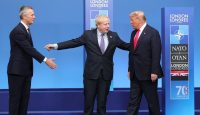 US president Donald Trump (right) is welcomed by British prime minister Boris Johnson (centre) and NATO secretary-general Jens Stoltenberg during the NATO Summit in London, December 2019. Photo by Mustafa Kamaci/Anadolu Agency via Getty Images.