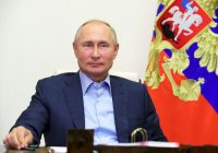 Russian President Vladimir Putin attends a meeting with winners of the Leaders of Russia contest via video conference at the Novo-Ogaryovo residence outside Moscow on Tuesday. (Mikhail Klimentyev/Sputnik/AP)