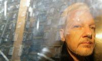 Julian Assange is taken from court in London in May 2019. Photograph: Matt Dunham/AP