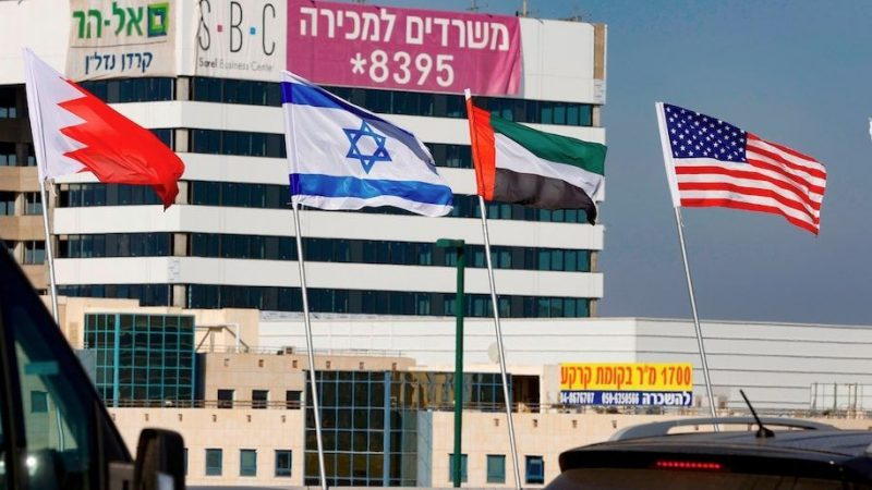 The flags, from left to right, of Bahrain, Israel, the United Arab Emirates and the United States fly along a road in the resort city of Netanya, in central Israel, on Sept. 13. (Jack Guez/AFP/Getty Images)