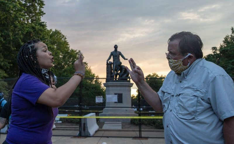 Tasos Katopodis/Getty Images Protesters for and against the removal of the Emancipation Memorial arguing as workers install a fence to protect the monument in Lincoln Park, Washington, D.C., June 25, 2020
