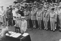 General of the Army Douglas MacArthur, the supreme Allied commander, and Gen. Jonathan Wainwright, who surrendered to the Japanese after Bataan and Corregidor, witness the formal Japanese surrender signatures aboard the battleship USS Missouri in Tokyo Bay on Sept. 2, 1945. (AP)