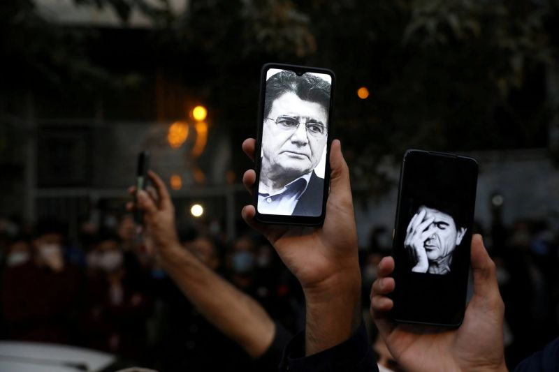 Images of the singer Mohammad Reza Shajarian on the cellphones of fans gathered outside the Tehran hospital where he died. Credit  Majid Asgaripour/West Asia News Agency, via Reuters