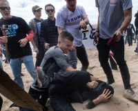 Mindy Schauer/Orange County Register via ZUMA Wire Robert Rundo attacking a counter-protester as other Rise Above Movement members look on, Huntington Beach, California, March 25, 2017