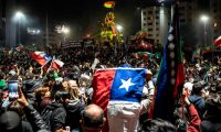 Demonstrators supporting the reform of the Chilean constitution in Santiago, 25 October. Photograph: Pedro Ugarte/AFP/Getty Images