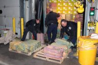U.S. Customs and Border Protection agents unload a truck containing 3,200 pounds of cocaine in 60 packages in Newark in February 2019. (U.S. Customs and Border Protection/AP)