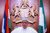 Nigerian President Muhammadu Buhari addresses the nation on a live televised broadcast on Oct. 22. (Bayo Omoboriowo/AP)