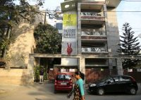 A woman walks past the Amnesty International India headquarters in Bangalore in 2019. (Aijaz Rahi/AP)