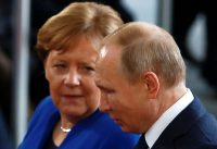 President Vladimir Putin and Chancellor Angela Merkel. His turn to revisionist nationalism has called into question Germany's decades-old approach to Russia. Credit Michele Tantussi/Reuters