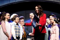 "New Zealand Prime Minister and Labour Party leader Jacinda Ardern meets the cast of ""Mary Poppins, The Musical"" on Oct. 15 in Auckland. New Zealand general election, delayed a month due to the coronavirus outbreak and subsequent lockdowns, is Saturday. (Hannah Peters/Getty Images)"