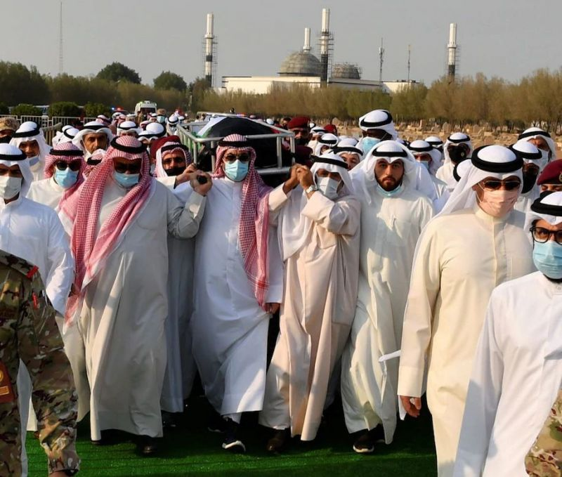 Mourners carry the body of Sheikh Sabah Ahmed al-Sabah at Sulaibikhat Cemetery in Kuwait City on Wednesday. (Kuna/EPA-EFE/Shutterstock)