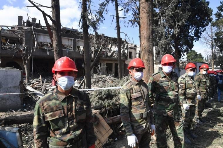 Employees of the Ministry of Emergency Situations work near destroyed houses in Ganja, Azerbaijan on 11 October 2020. They were hit by shelling after fighting between Armenian and Azerbaijani forces began in and around Nagorno-Karabakh on 27 September. Mikhail Voskresenskiy / Sputnik via AFP.