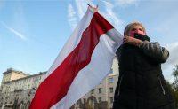 Natalia Fedosenko/TASS via Getty Images An opposition supporter during the March of Seniors in Minsk, Belarus, October 19, 2020