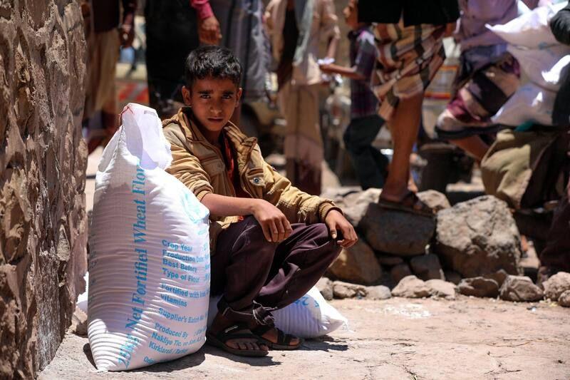 A Yemeni boy receives humanitarian aid donated by the World Food Program in Taez, Yemen, on Saturday. (Ahmad Al-Basha/AFP/Getty Images)