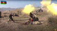 Azerbaijan army soldiers fire artillery in fighting in Nagorno-Karabakh. (Azerbaijan's Defense Ministry via AP)