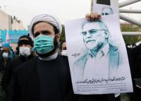 A protester holds a picture of Mohsen Fakhrizadeh during a demonstration against the nuclear scientist's killing in Tehran on Saturday. Credit Wana/Reuters