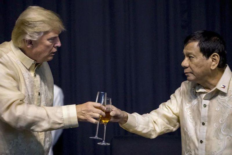 President Trump toasts with Philippines President Rodrigo Duterte at a summit dinner in Manila on Nov. 12, 2017. (Andrew Harnik/AP)