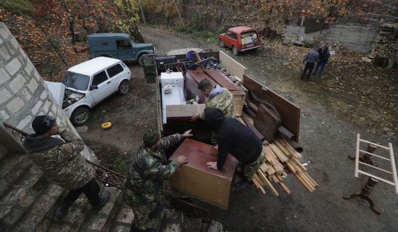 Photo by: Sergei Grits Ethnic Armenians load a truck as they prepare to leave their home in the village of Maraga, in the Martakert area, in the separatist region of Nagorno-Karabakh, Wednesday, Nov. 18, 2020. A Russia-brokered cease-fire to halt six weeks of fighting over Nagorno-Karabakh stipulated that Armenia turn over control of some areas it holds outside the separatist territory's borders to Azerbaijan. Armenians are forced to leave their homes before the region is handed over to control by Azerbaijani forces. (AP Photo/Sergei Grits)
