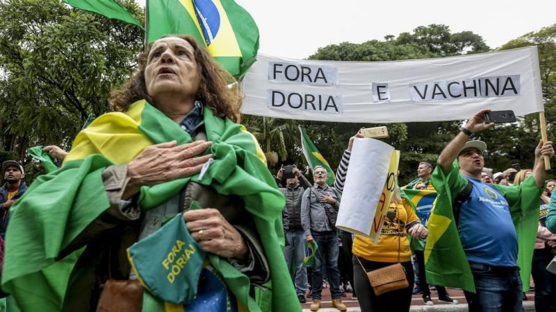 Supporters of President Jair Bolsonaro met on Avenida Paulista to demand the impeachment of the Governor of São Paulo Joao Doria (PSDB) and against the mandatory vaccination of the COVID-19 in São Paulo. Suamy Beydoun / AGIF / via AFP
