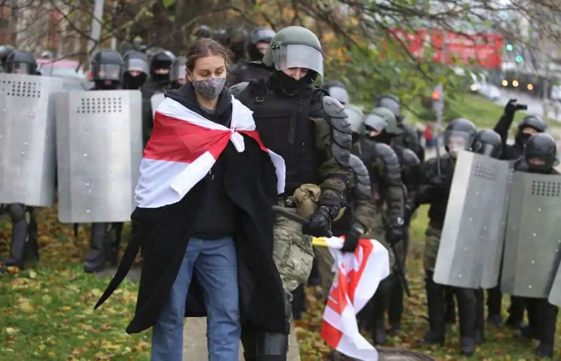 Police detain a protester during an opposition rally over the official presidential election results in Minsk, Belarus, on Nov. 8. (AP)