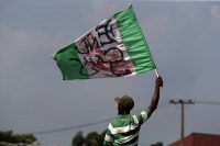 A demonstrator holds a stained Nigerian flag during a protest in Lagos, Nigeria, last month against the Special Anti-Robbery Squad police unit, known as SARS. (Akintunde Akinleye/EPA-EFE/REX/Shutterstock)