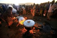Ethiopian refugees fleeing from the ongoing fighting in the Tigray region wait for food at the Um-Rakoba camp on the Sudan-Ethiopia border, in Al-Qadarif state, Sudan, on Nov. 23. (Mohamed Nureldin Abdallah/Reuters)
