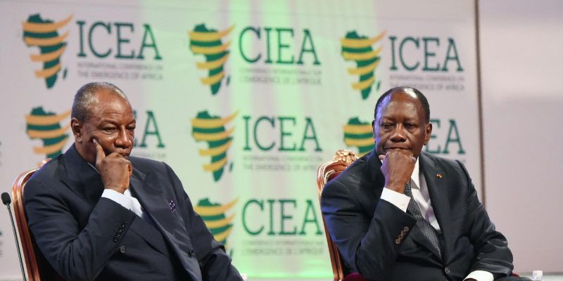 Côte D'Ivoire president Alassane Ouattara (right) and Guinean counterpart Alpha Condé at the opening of the 2017 International Conference on the Emergence of Africa. Photo by SIA KAMBOU/AFP via Getty Images.