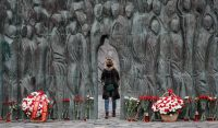 A woman attends a memorial for Gulag victims in Moscow on Oct. 30. (Yuri Kochetkov/EPA-EFE/REX/Shutterstock)