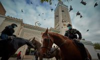Mounted police patrol guard the Grand Mosque in Paris during prayers last Friday. Photograph: Kiran Ridley/Getty Images