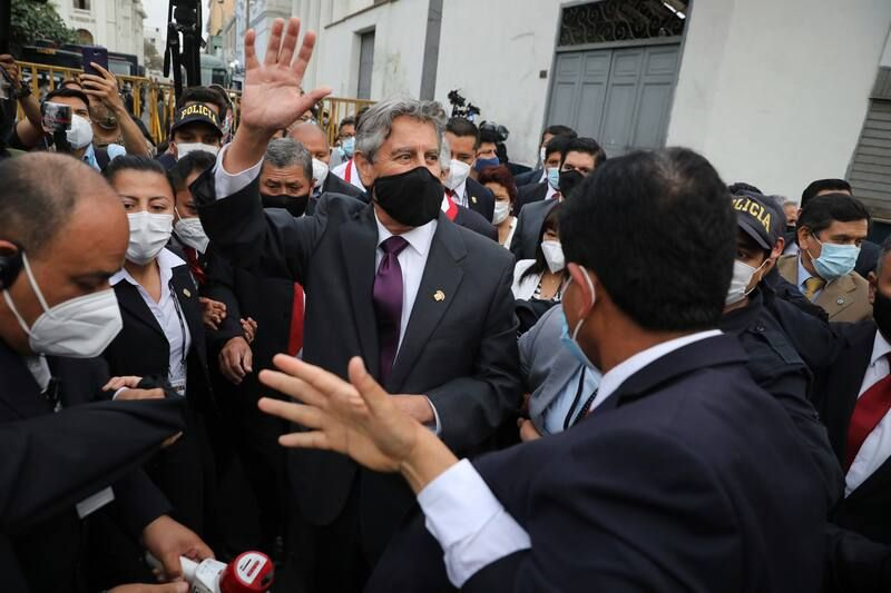Peru's new interim president, Francisco Sagasti, waves to the crowd in Lima on Monday after he was designated by Congress to lead the nation. (Rodrigo Abd/AP)