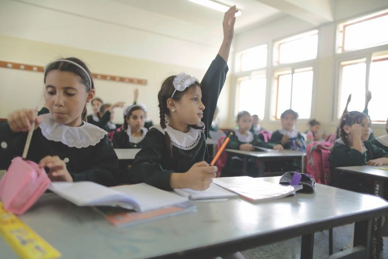 Jehad al-Saftawi Nine-year-old Alaa Habib raising her hand in class at the Subhi Abu Karsh School, which was heavily damaged during Operation Protective Edge the year before, Gaza, August 31, 2015