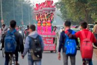 Workers push a fancy light trolley used for wedding ceremonies on a road in Allahabad, India, on Saturday. (Sanjay Kanojia/AFP/Getty Images)