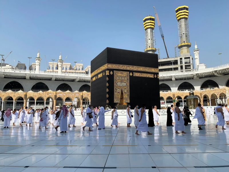Keeping a social distance, people visit the Grand Mosque in Mecca as part of umrah, a form of Islamic pilgrimage, in October. Earlier in the year, Saudi authorities enforced coronavirus restrictions that drastically limited pilgrims' access to the holy city. Credit Marwa Rashad/Reuters