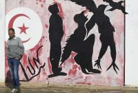Graffiti shows a man turning into a bird in Sidi Bouzid, Tunisia, on Oct. 27. (Fethi Belaid/AFP/Getty Images)