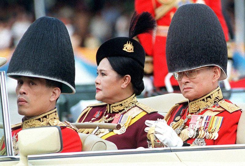 King Bhumibol Adulyadej, right, Queen Sirikit and Crown Prince Maha Vajiralongkorn in December 2000 during festivities in Bangkok for the king's 73rd birthday. Credit Pornchai Kittiwongsakul/Agence France-Presse — Getty Images
