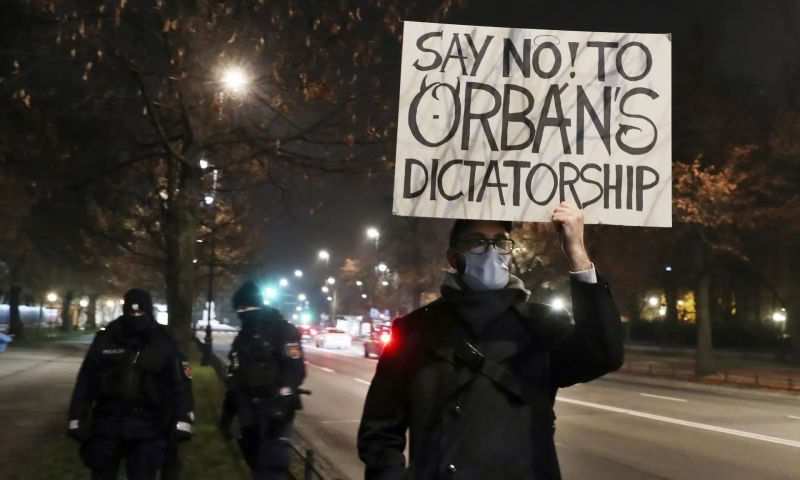 'It is not an exaggeration to say that democracy is under threat in Poland and Hungary.' A man protesting in Hungary as Viktor Orbán and Polish prime minister Mateusz Morawiecki meet. Photograph: Czarek Sokołowski/AP