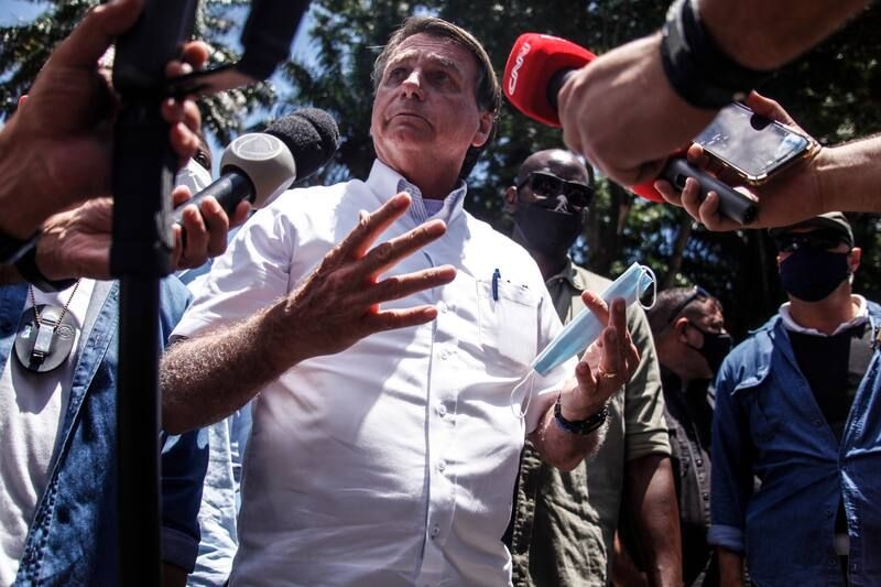 Brazilian President Jair Bolsonaro talks to the media after voting during the municipal elections in Rio de Janeiro on Nov. 29. (Luis Alvarenga/Getty Images)