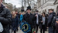 A man in funeral attire carried a European Union wreath on Jan. 31, the day Britain formally withdrew from the bloc. Credit Andrew Testa for The New York Times
