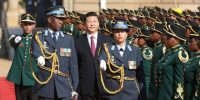 Chinese president Xi Jinping walks past a guard of honour at the Union Buildings in Pretoria, during the start of an official tour to South Africa in 2015. Photo by KAREL PRINSLOO/AFP via Getty Images.