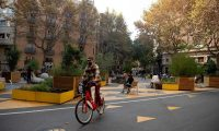 "'Barcelona's ""superblock"" plan will transform the entire central grid of the city into a greener and almost car-free area.' A cyclist in one of Barcelona's traffic-free zones, November 2020. Photograph: Josep Lago/AFP/Getty Images"