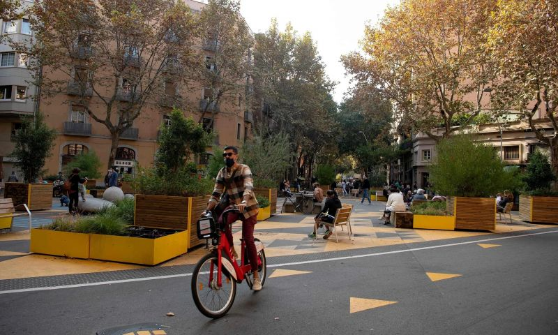 """'Barcelona's """"superblock"""" plan will transform the entire central grid of the city into a greener and almost car-free area.' A cyclist in one of Barcelona's traffic-free zones, November 2020. Photograph: Josep Lago/AFP/Getty Images"""