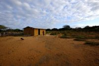 A Wayuu woman walks by her house in a rural community in La Guajira, Colombia. (Hilary Rosenthal)