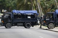 Policemen surround the residence of Henri Konan Bédié, former Ivorian head of state and current president of the National Transitional Council in Abidjan, Cote D'Ivoire, on Nov. 3. (Legnan Koula/EPA-EFE/REX/Shutterstock)