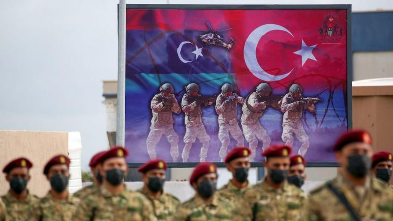 Libyan military graduates loyal to the UN-recognised Government of National Accord (GNA) take part in a parade marking their graduation, a result of a military training agreement with Turkey, at the Omar Mukhtar camp on 21 November 2020. Mahmud TURKIA / AFP